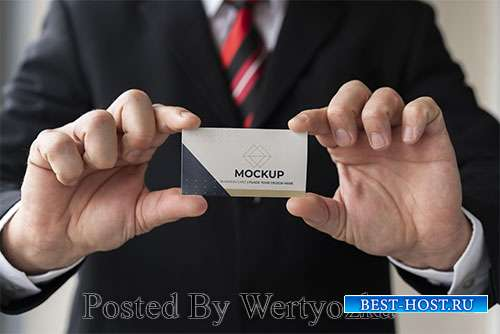 Close-up businessman holding business card mock-up with both hands